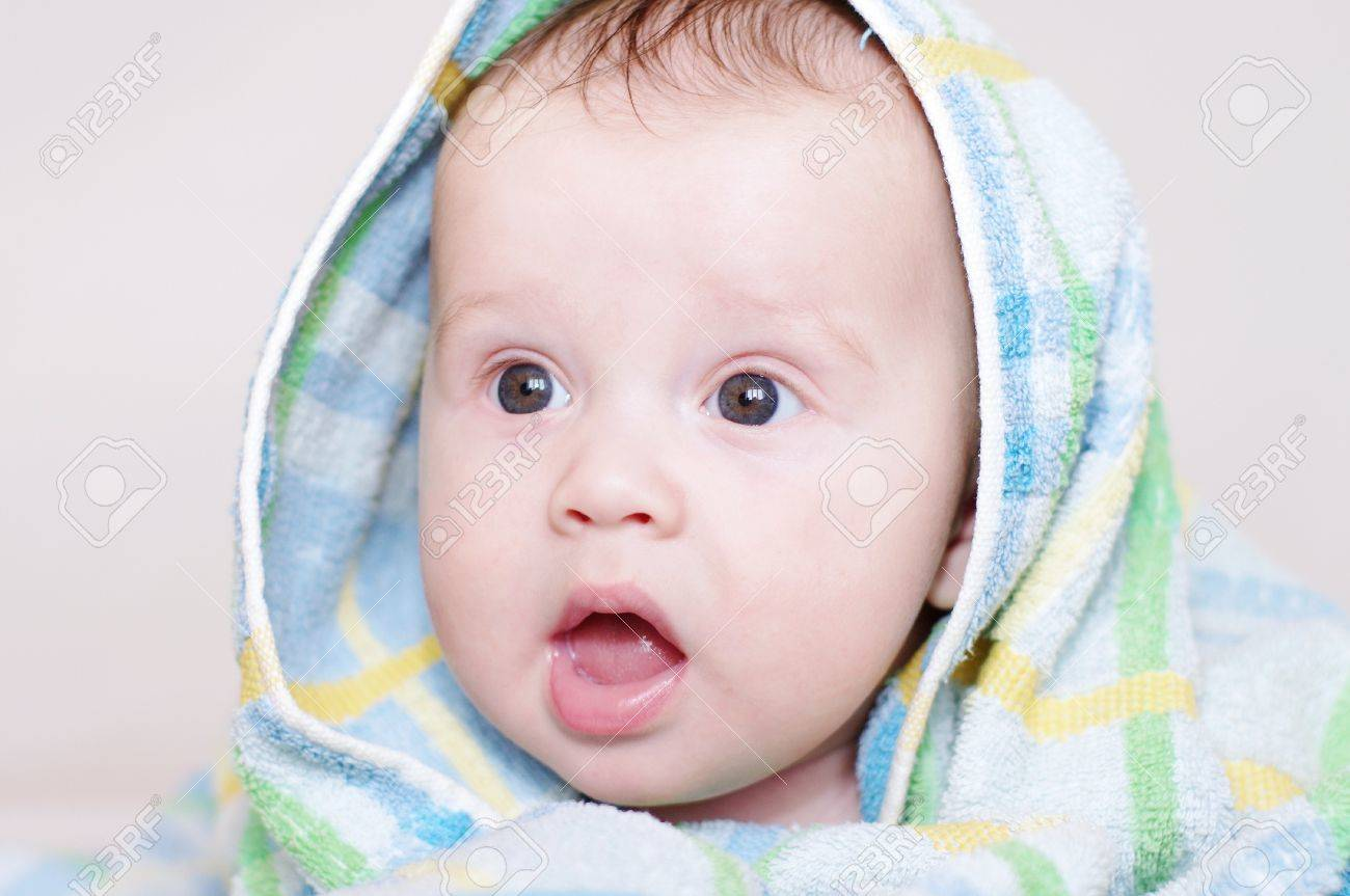 The funny baby in a blue blanket  4 months Stock Photo - 17567114