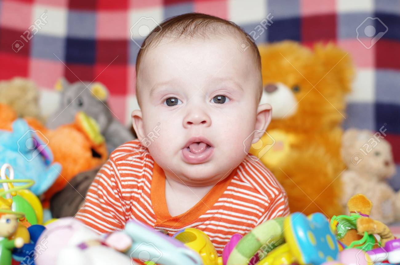 5 Months Baby Among Toys Stock Photo Picture And Royalty Free Image