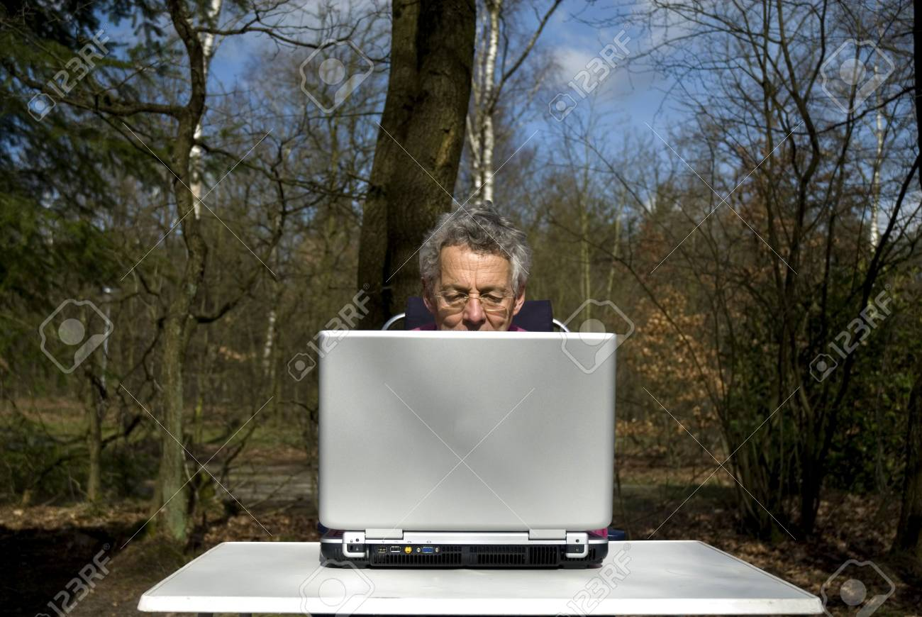 retired man is trying to learn working with laptop Stock Photo - 1158555