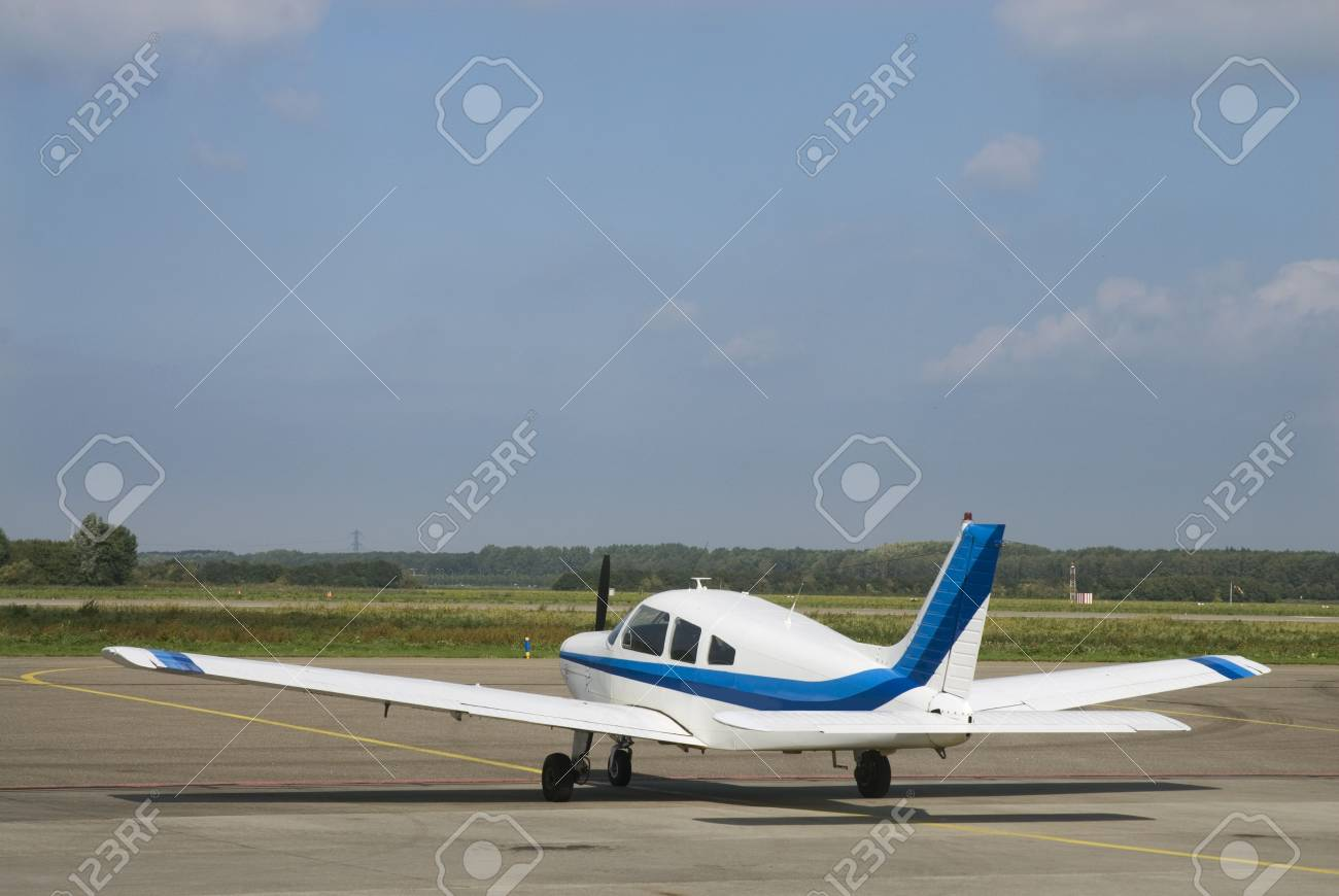 sportsmachine with blue stripes on the airport Stock Photo - 1896303