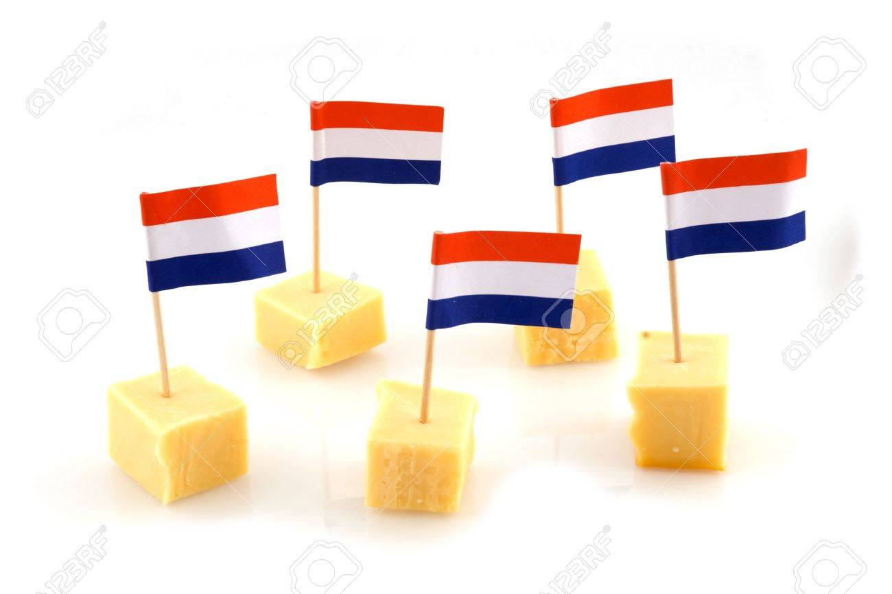 3125285-cubes-Dutch-Cheese-with-Dutch-little-flags-Stock-Photo.jpg