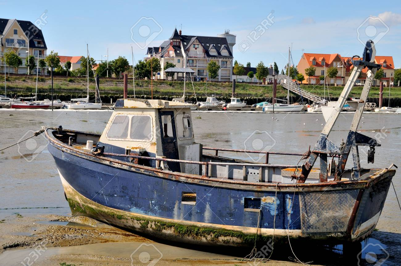 Damaged boat in Normandy the village Crotoy Stock Photo - 3842916