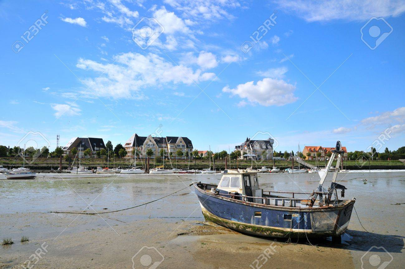 Ebb tide in the little harbor in Normandy Stock Photo - 3842886