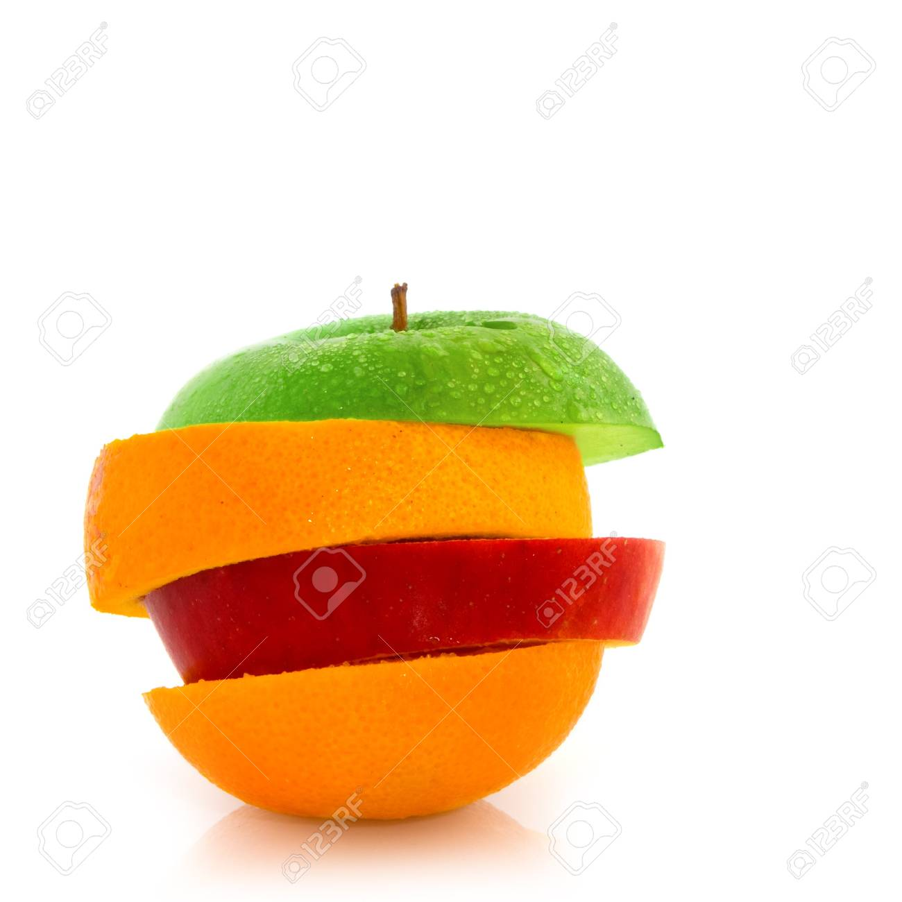 Juicy fresh fruit in slices isolated over white Stock Photo - 4429689
