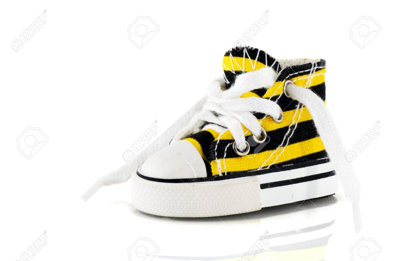 Yellow and black striped sporting shoe Stock Photo - 4508783