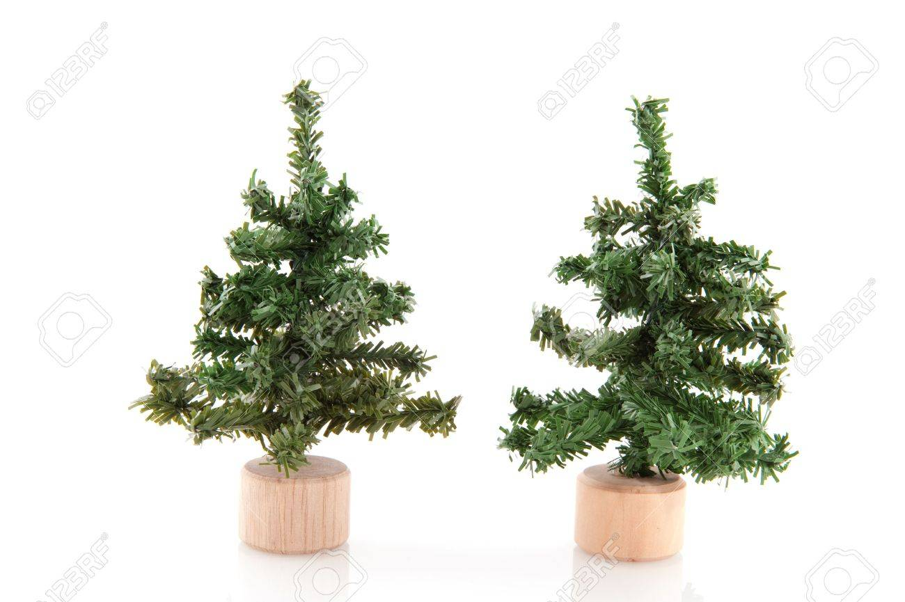 Charming Little Christmas Trees Part - 2: Two Little Christmas Trees Isolated Over White Stock Photo - 5962219
