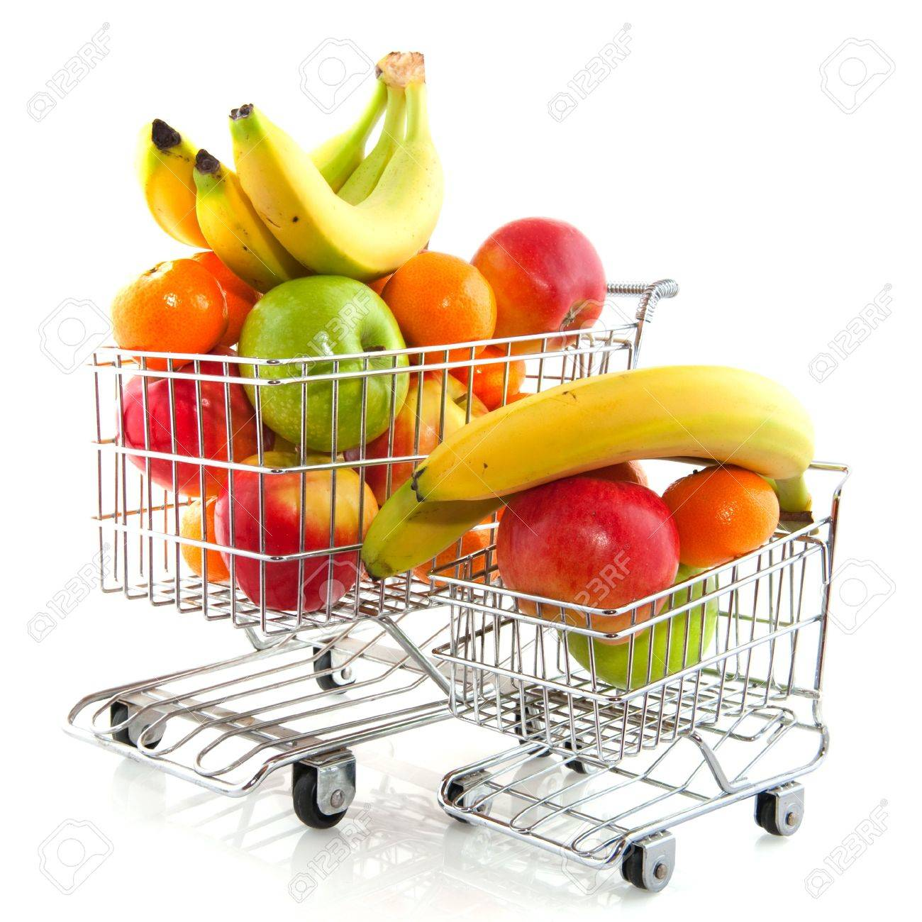 Shopping cart from the supermarket filled with fresh fruit Stock Photo - 6087229