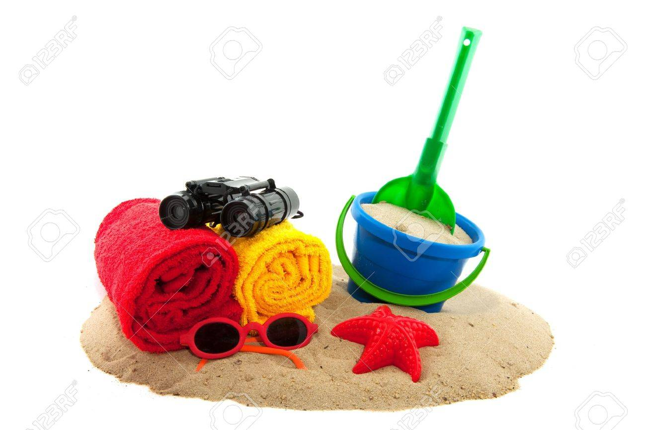 Summer vacation at the beach with towels and toys Stock Photo - 6219602