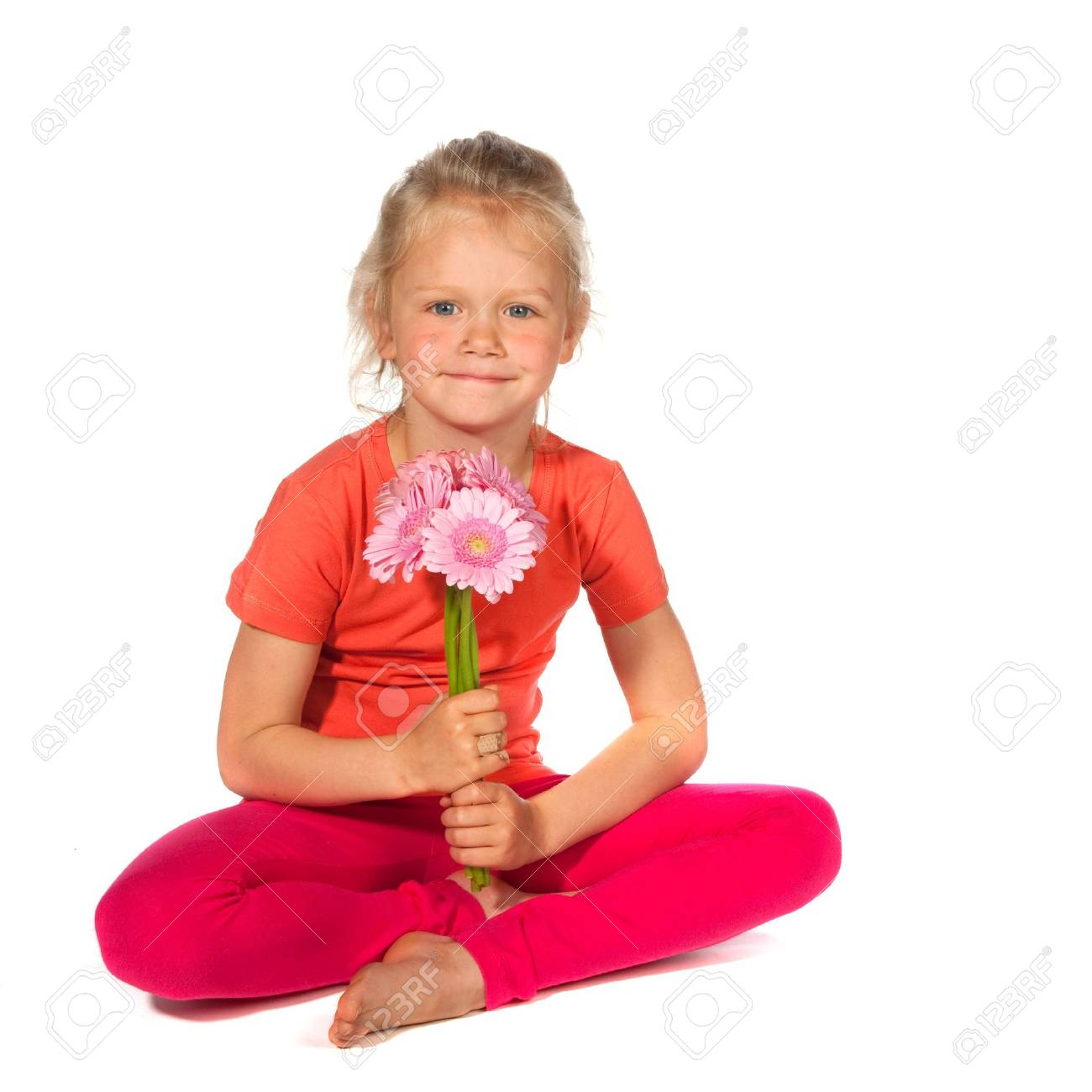 Lovely blond girl with flowers as a gift Stock Photo - 6370541