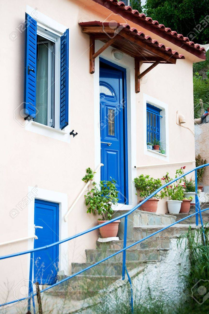 Traditional Greek Houses traditional greek houses with stair case and blue painted stock