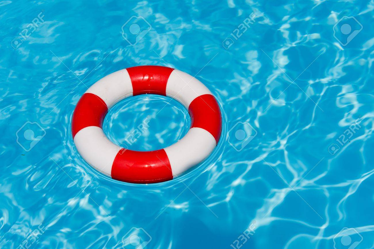 swimming pool with red and white life buoy Stock Photo - 6950582