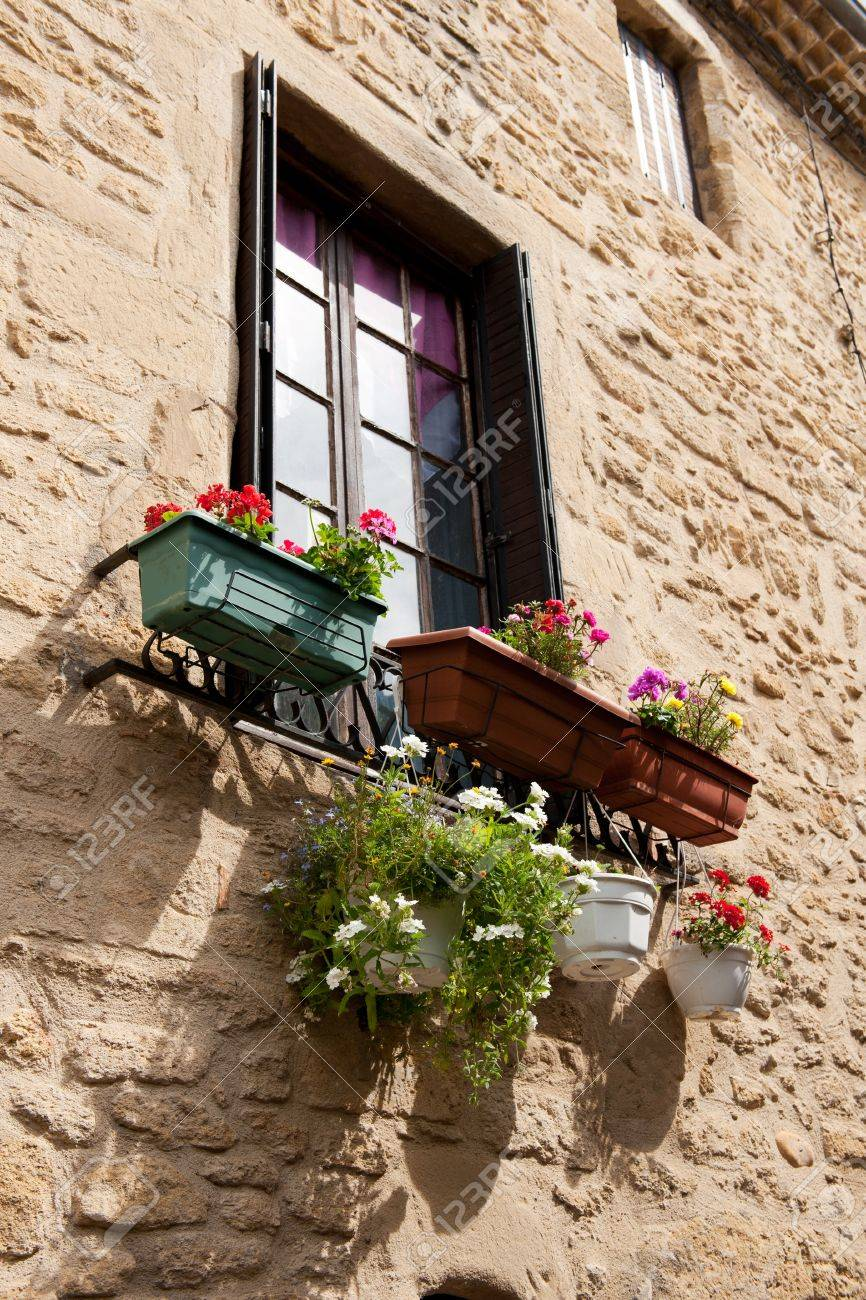 French window with romantic balcony and flowers фотография, .