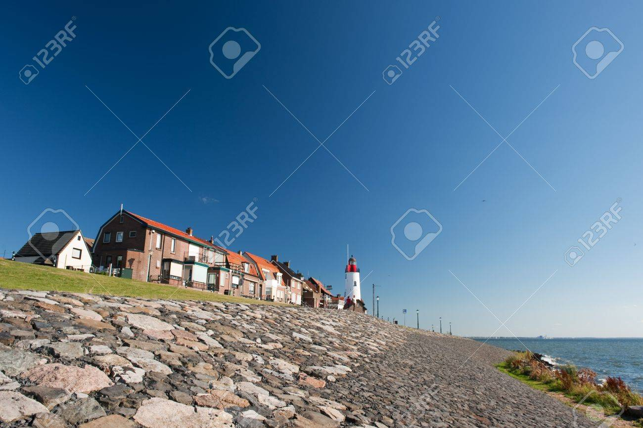 White lighthouse in little Dutch fishing village Urk Stock Photo - 7541669