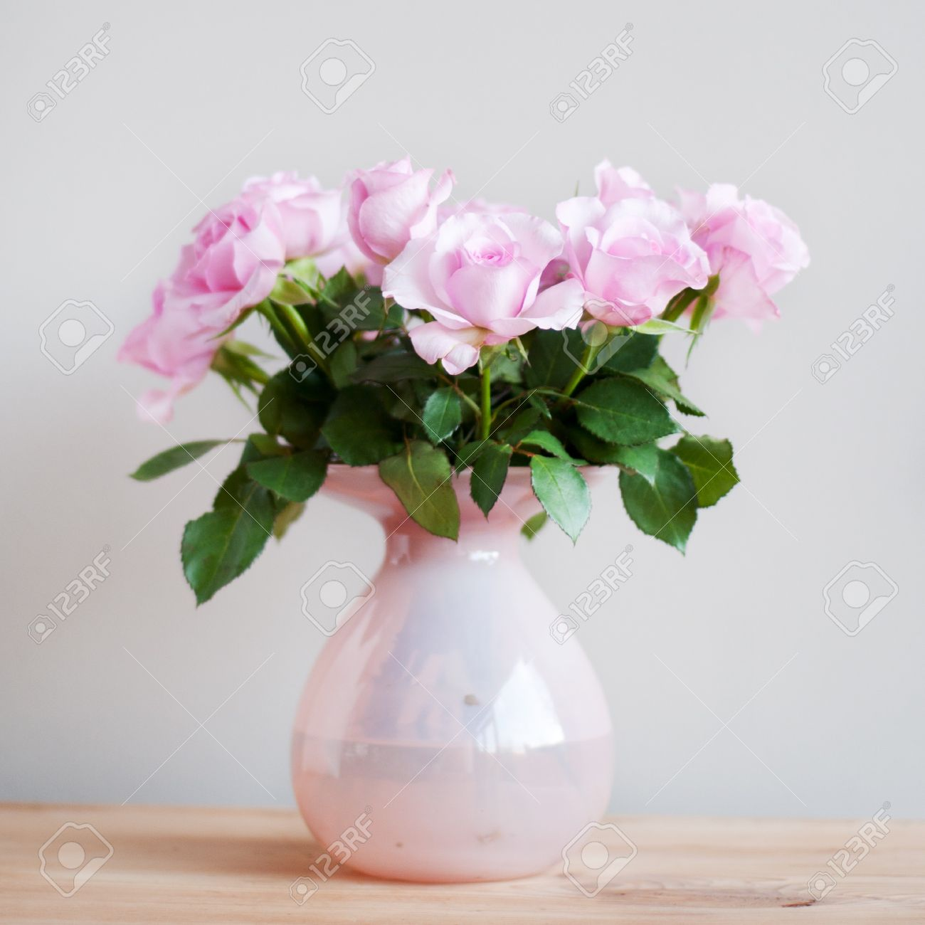Bouquet pink roses in vase in interior Stock Photo - 7541385