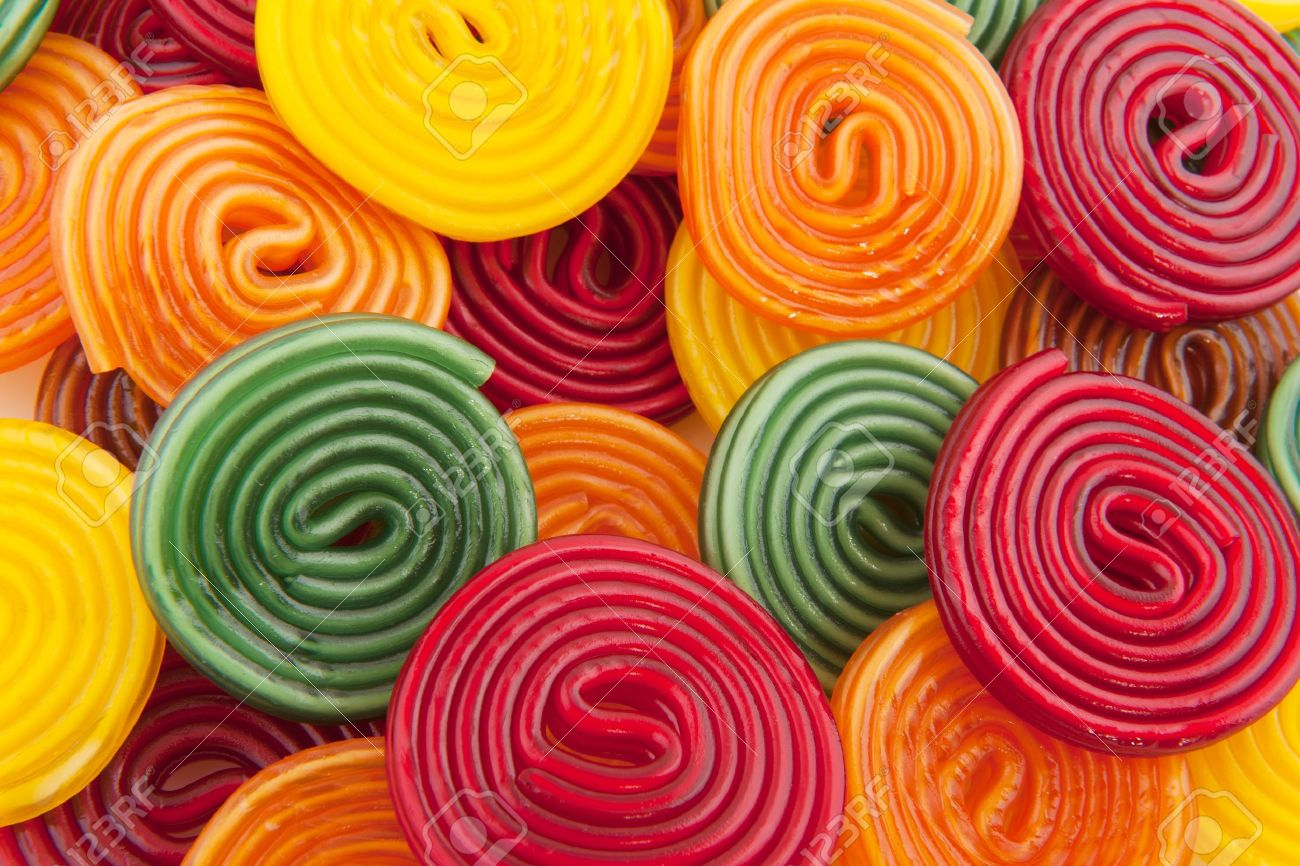 colorful licorice candy drop rolls as background Stock Photo - 7713101