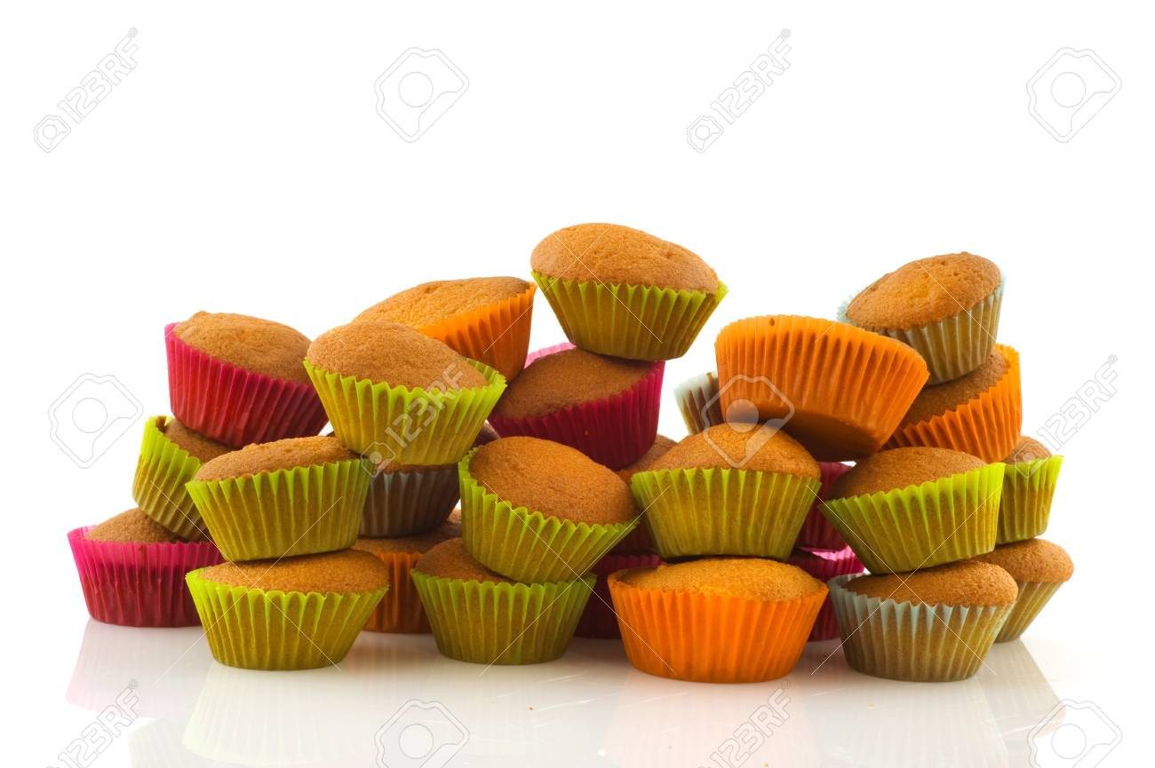 Many colorful muffins stacked and isolated over white Stock Photo - 8454814