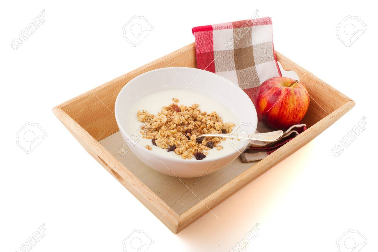 diet breakfast with yogurt muesli and a red apple Stock Photo - 8552037