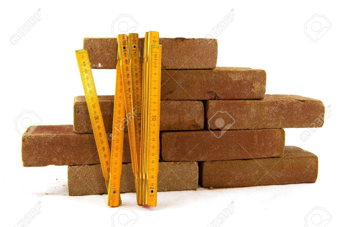 bricks and measuring tool to build a wall or making pavement Stock Photo - 8580519