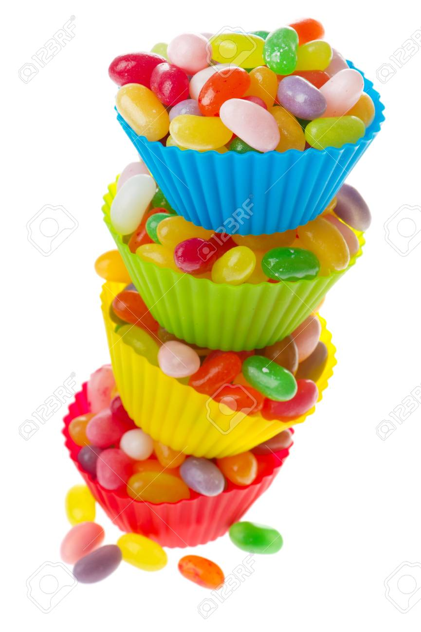 Colorful cups full with jelly beans isolated over white background Stock Photo - 9234595