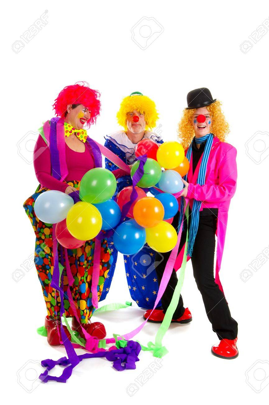 happy clowns are having a celebration with balloons stock photo