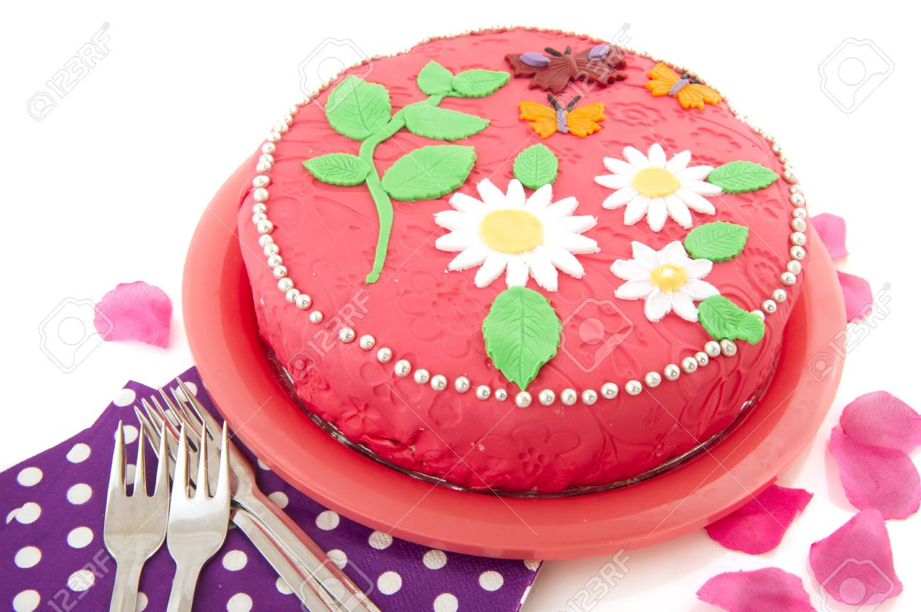 birthday cake in pink with napkins and forks Stock Photo - 9357370