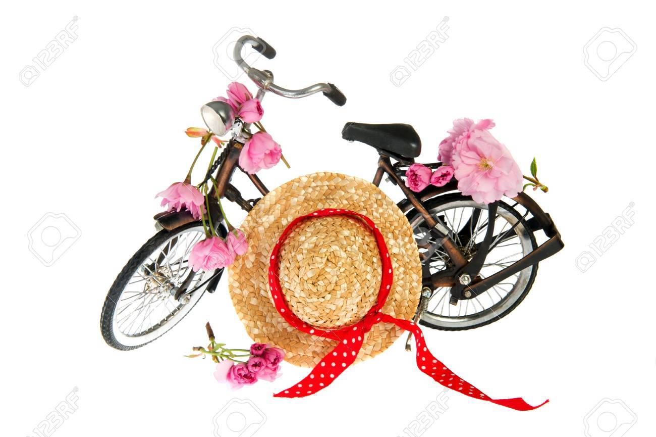 Old fashioned female summer bike with flowers and hat Stock Photo - 9414471