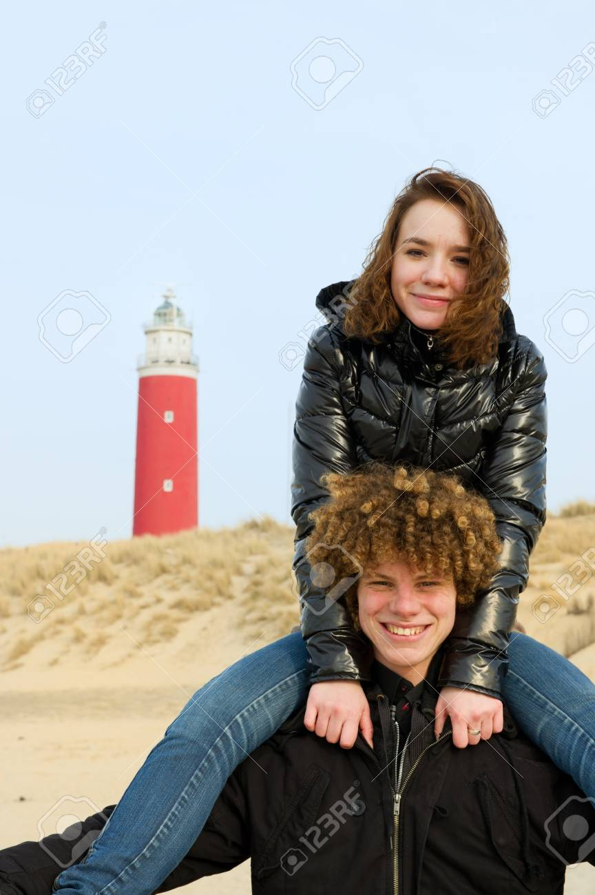 Young couple has fun at the beach Stock Photo - 9419544