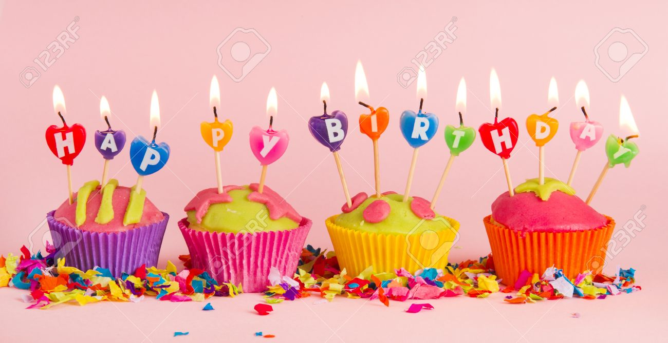 Cup Cakes With Burning Happy Birthday Candles Stock Photo