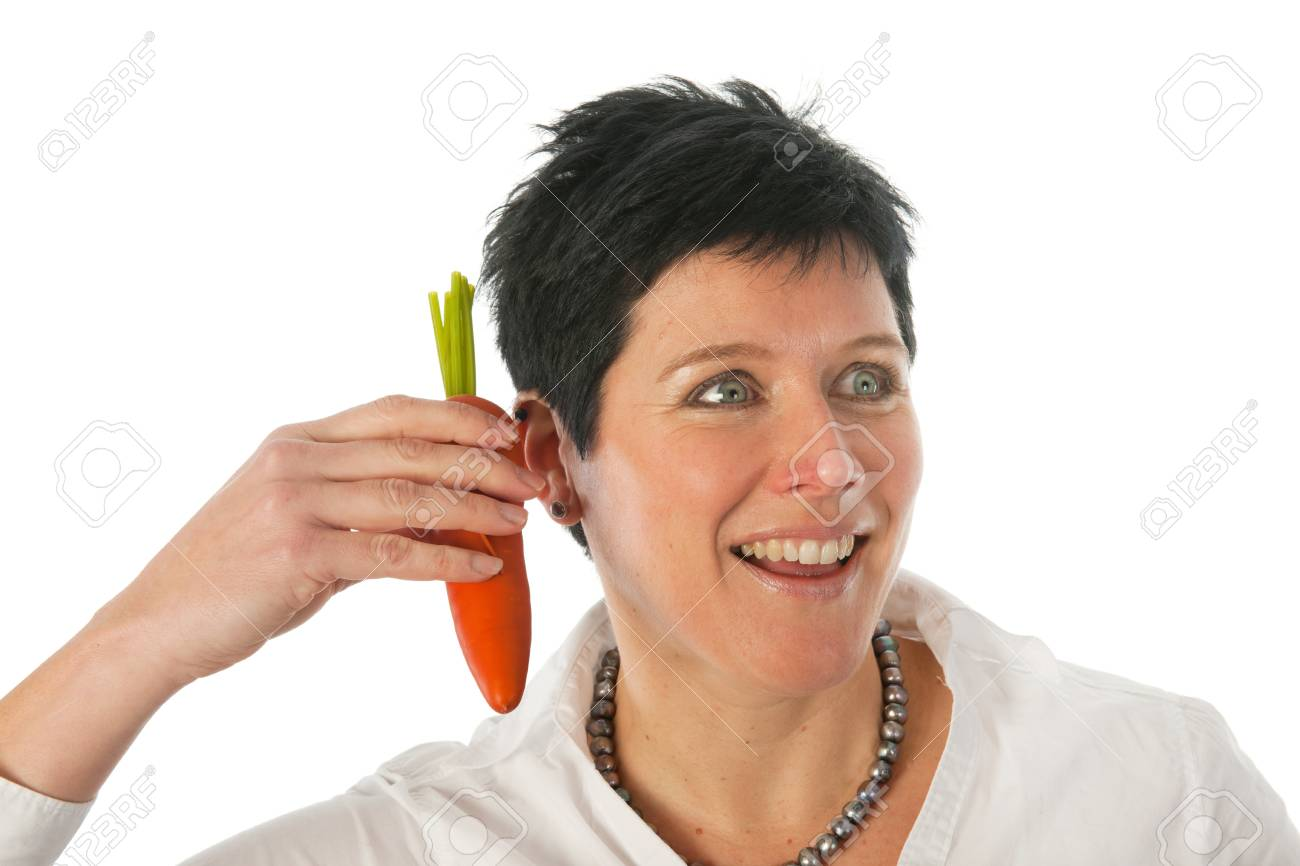 Funny portrait of woman with good news from a carrot Stock Photo - 12338497