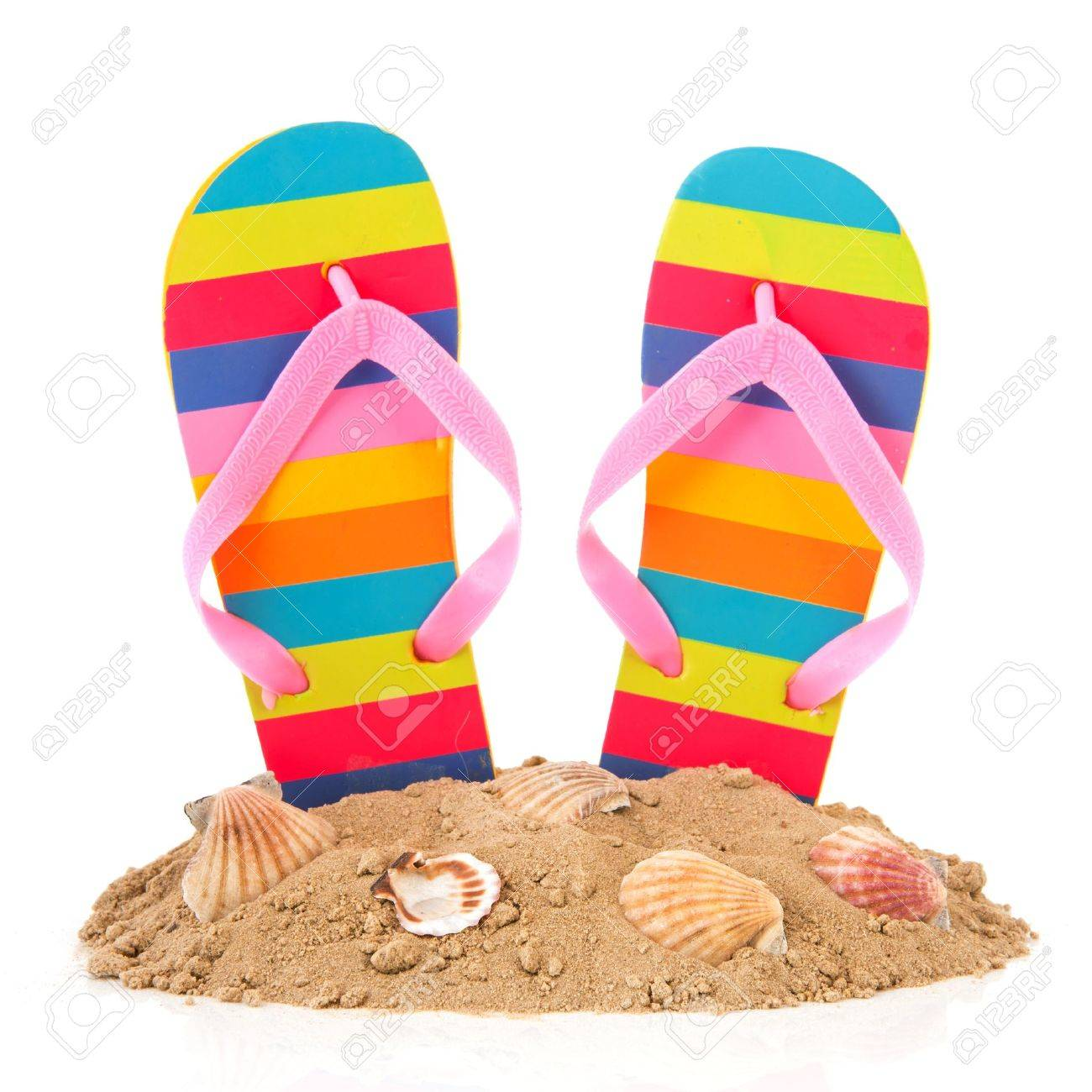 fb7ece01904 Colorful striped flip flops at the summer beach Stock Photo - 12340059