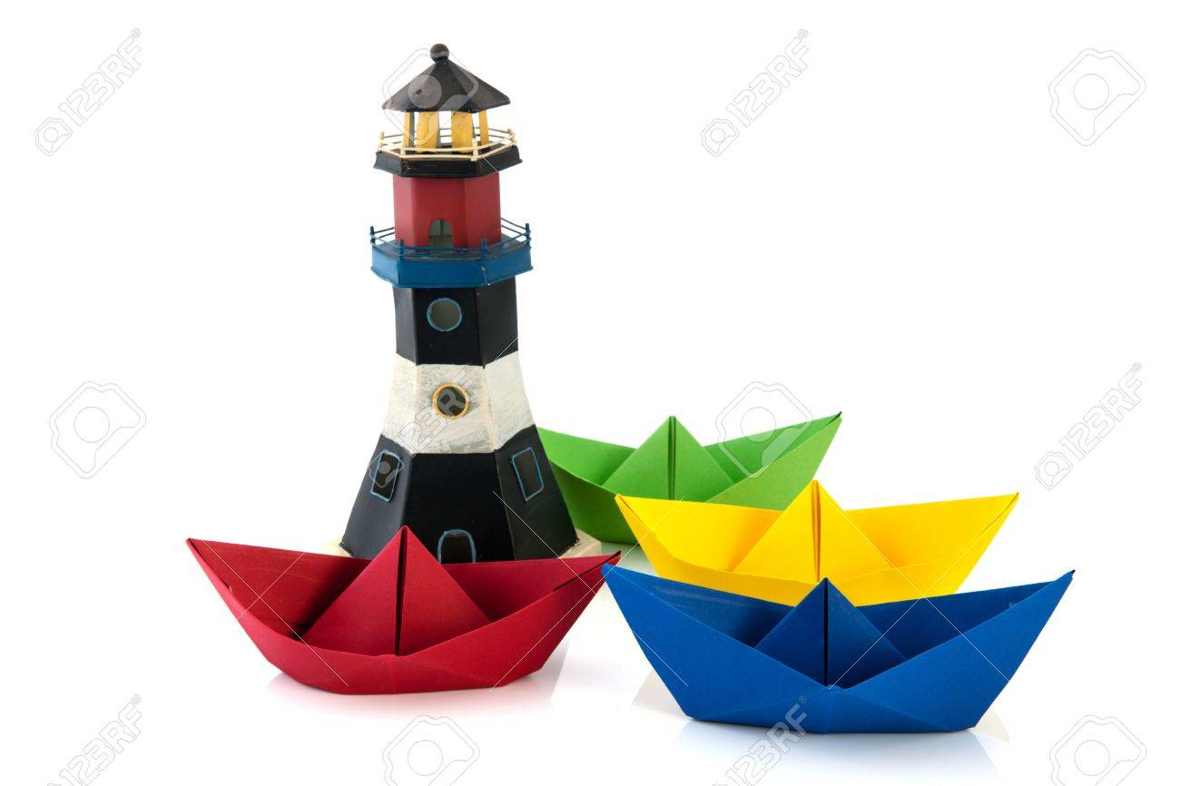 Colorful Folded Paper Boats With Lighthouse Isolated Over White