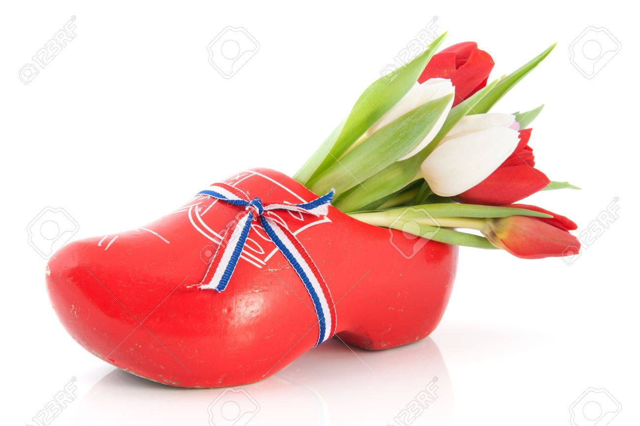 red dutch wooden clogs with colorful tulips stock photo picture