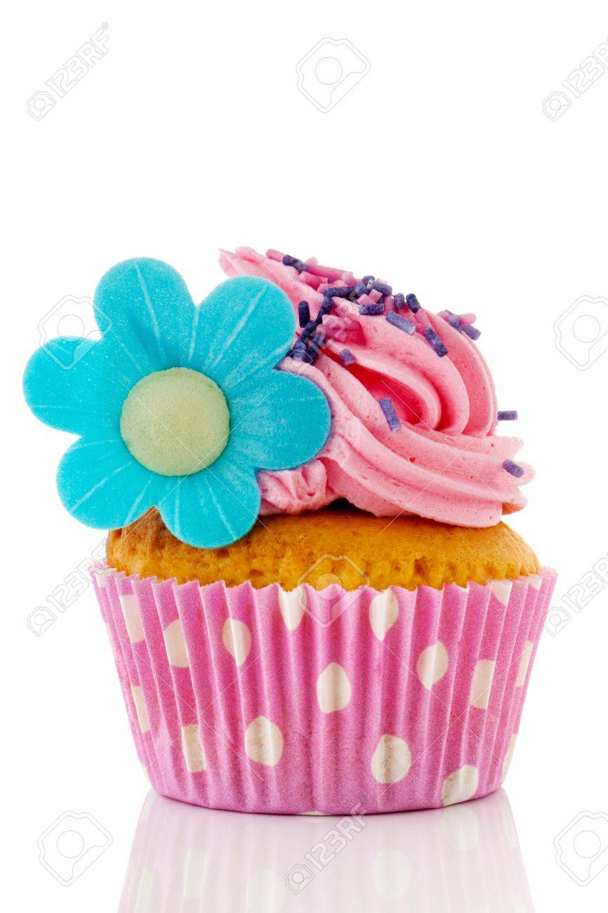 Pink Cupcake With Sprinkles And Blue Flower Isolated Over White Stock Photo Picture And Royalty Free Image Image 13863539