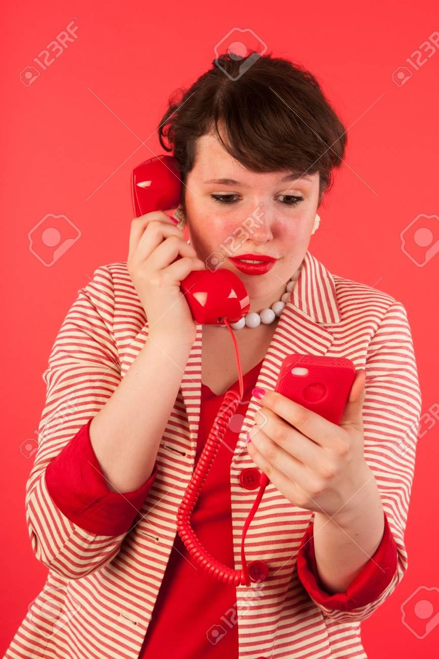 Young woman is having good news through her earphone connected at the smartphone Stock Photo - 15125615