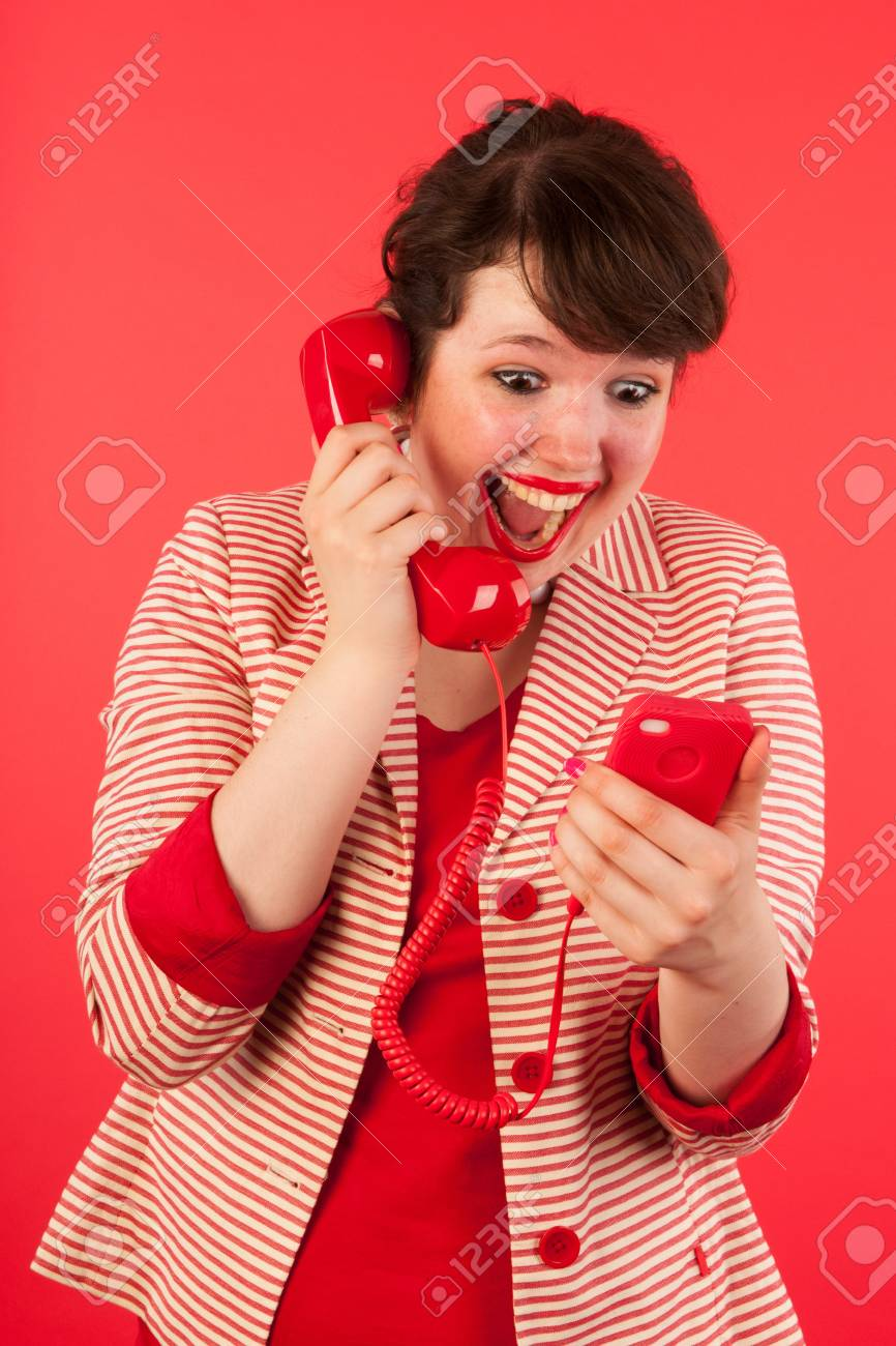 Young woman is having good news through her earphone connected at the smartphone Stock Photo - 15125613