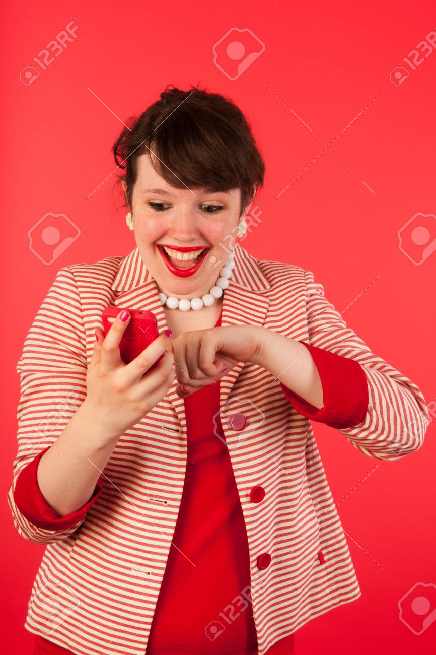 Young woman is having good news at the smartphone Stock Photo - 15125584