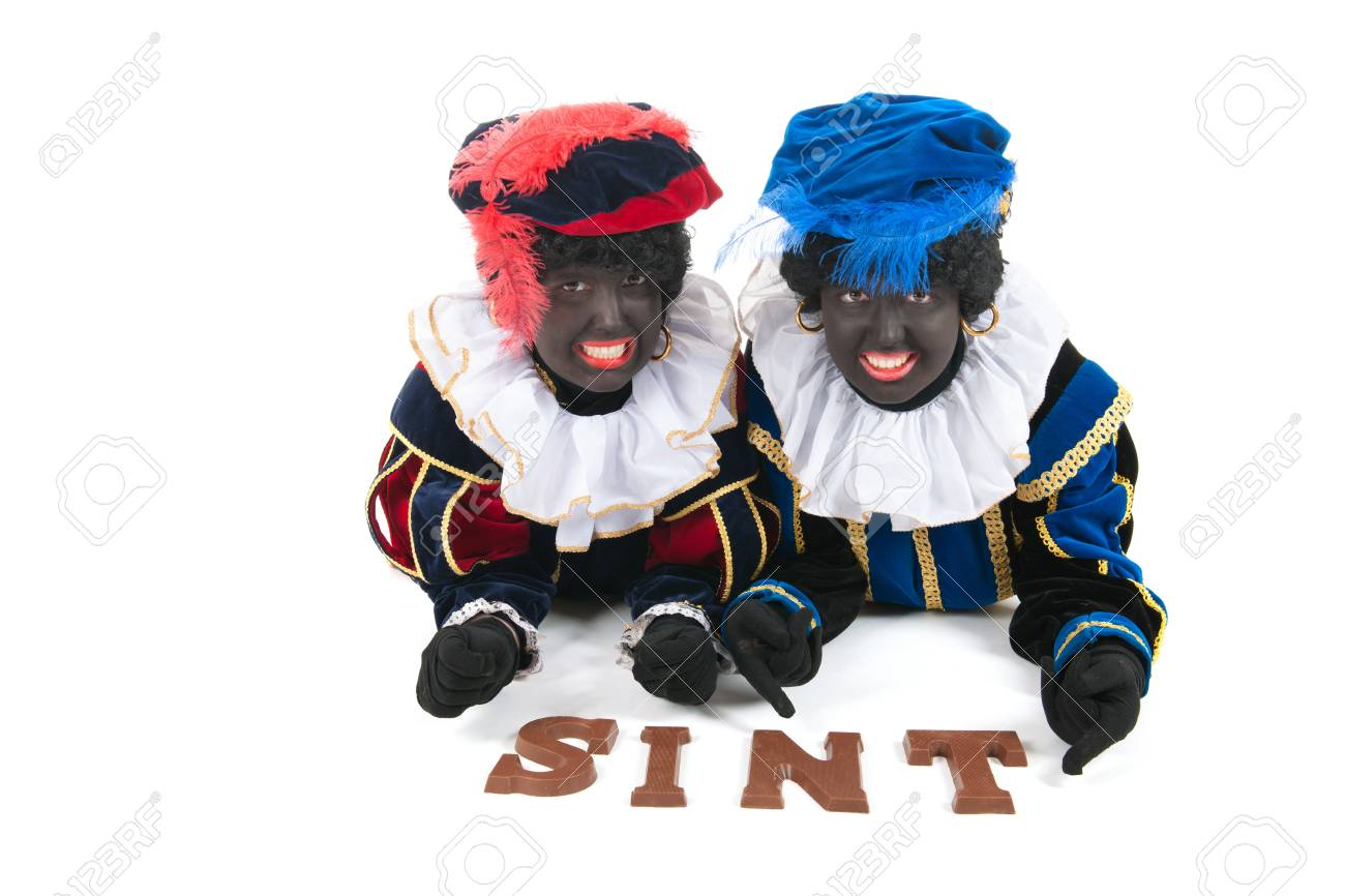 Dutch characters as black petes for typical Sinterklaas holidays laying with chocolate letters Stock Photo - 15998999