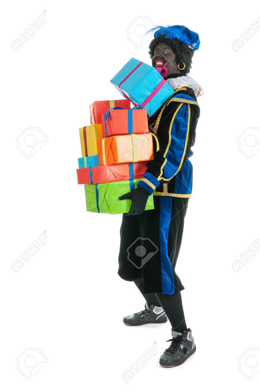 Dutch character as black pete for typical Sinterklaas holidays with many presents Stock Photo - 15988802
