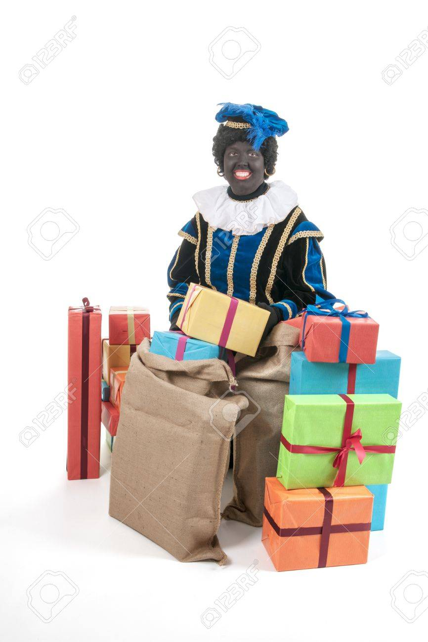 Dutch character as black pete for typical Sinterklaas holidays with many presents Stock Photo - 16303509