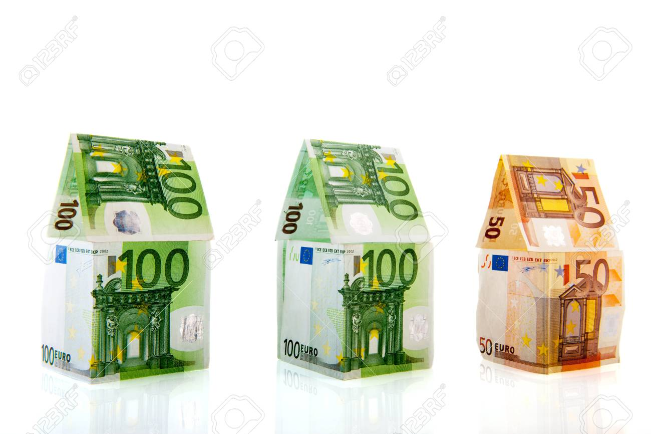 Row green and orange money houses from European banknotes