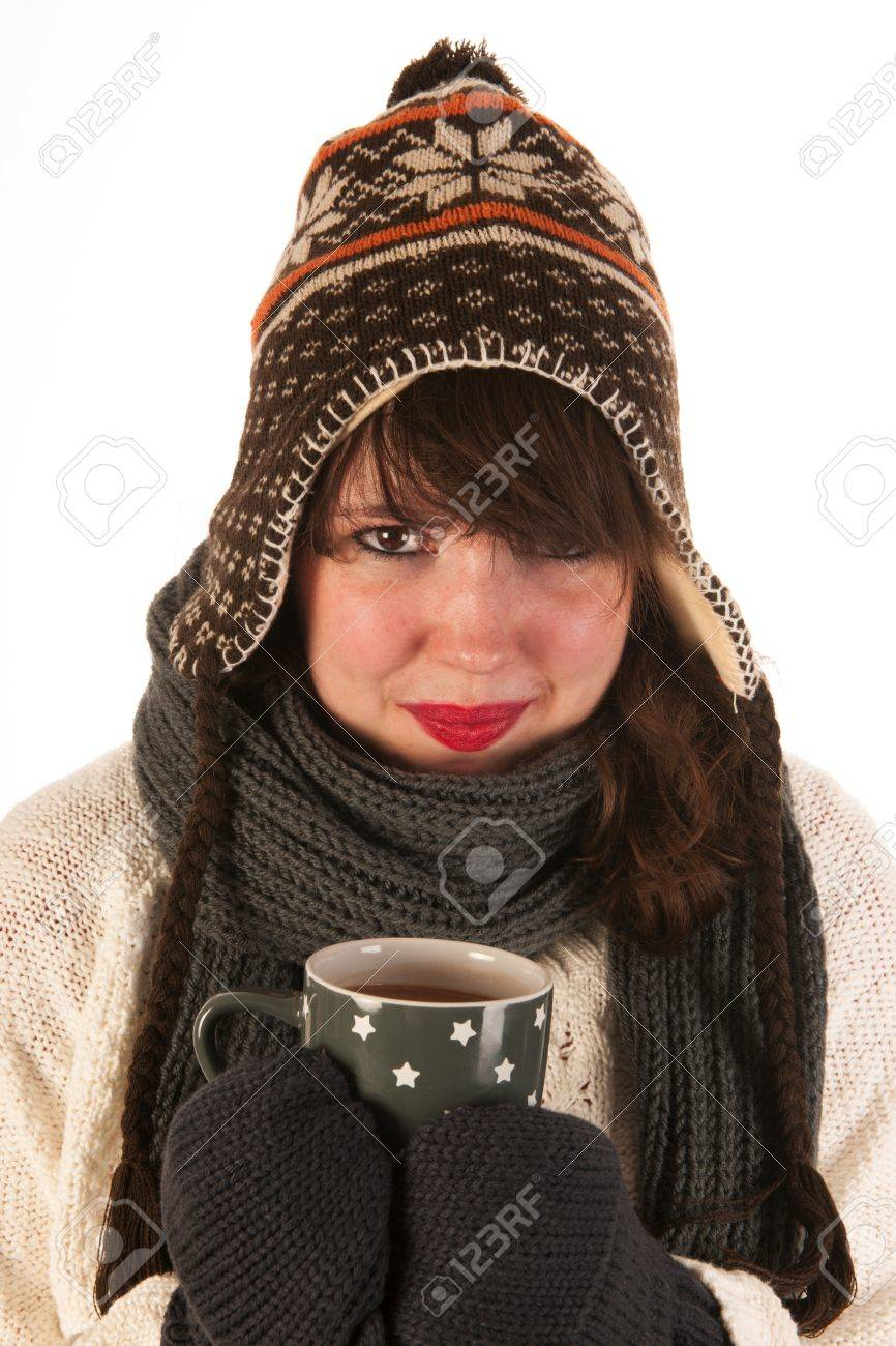 1cfab8f94d1 Stock Photo - Winter girl with wool sweater ice cap and gloves is drinking  hot chocolate