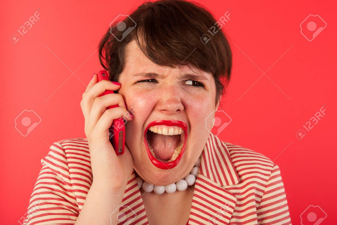 Young woman is having an angry phone call at the smartphone Stock Photo - 17362712