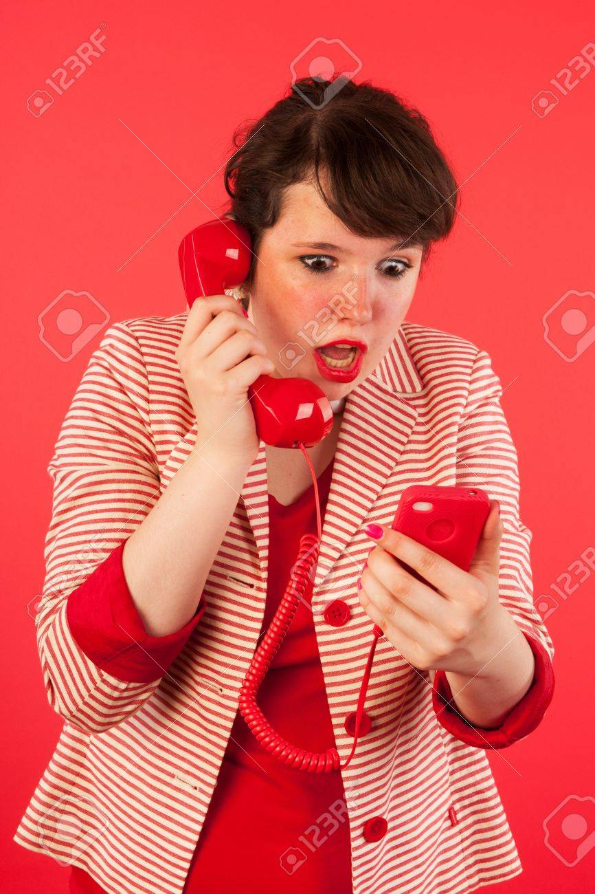 Young woman is having great news through her earphone connected at the smartphone Stock Photo - 17362713