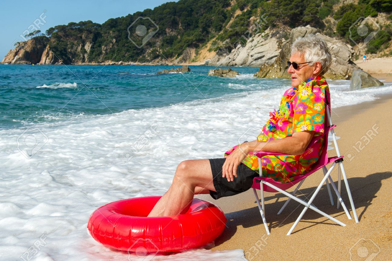Senior Man Sitting In Chair With Toys At The Summer Beach Stock Photo Picture And Royalty Free Image Image 17793684