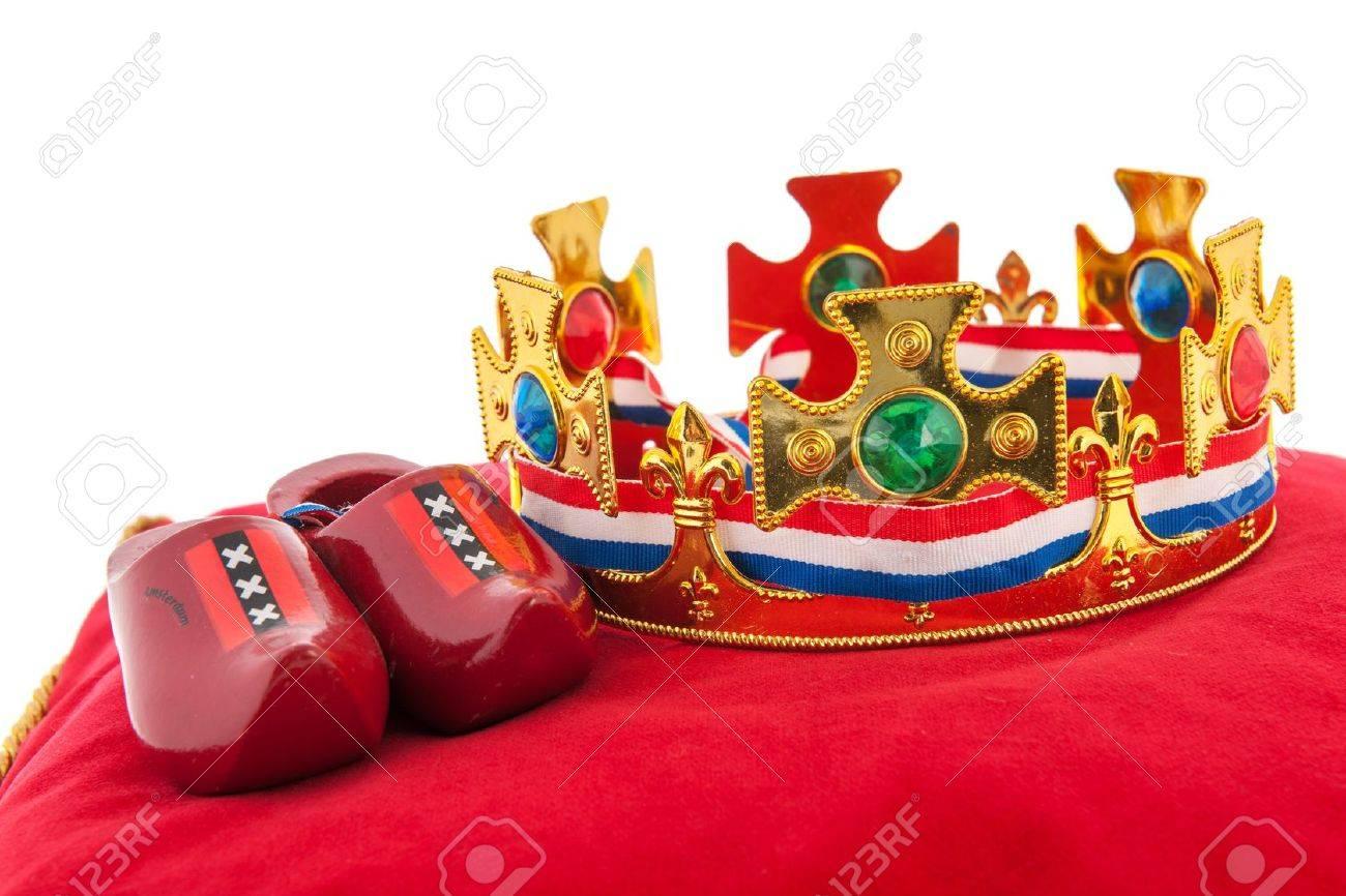 Golden crown on red velvet pillow for coronation in Holland Stock Photo - 18501968