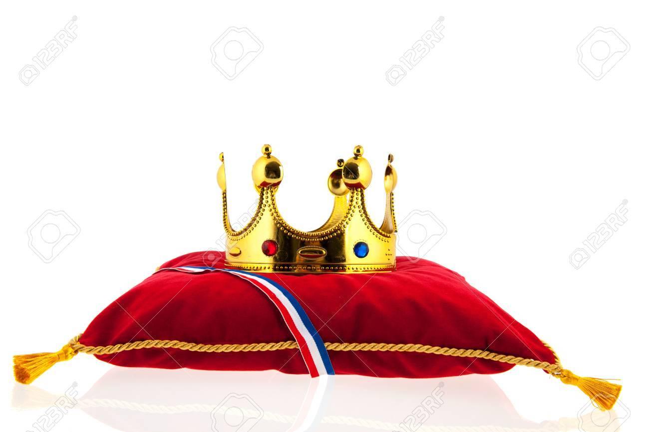 Golden crown on red velvet pillow for coronation in Holland Stock Photo - 18821074