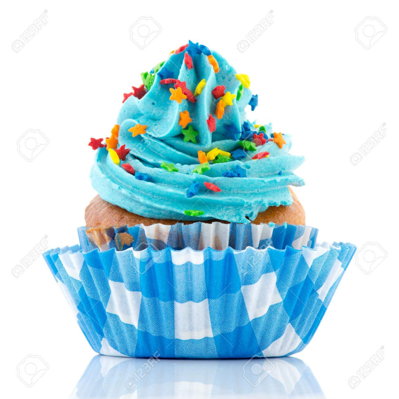Blue Birthday Cupcake With Confetti Isolated Over White Background