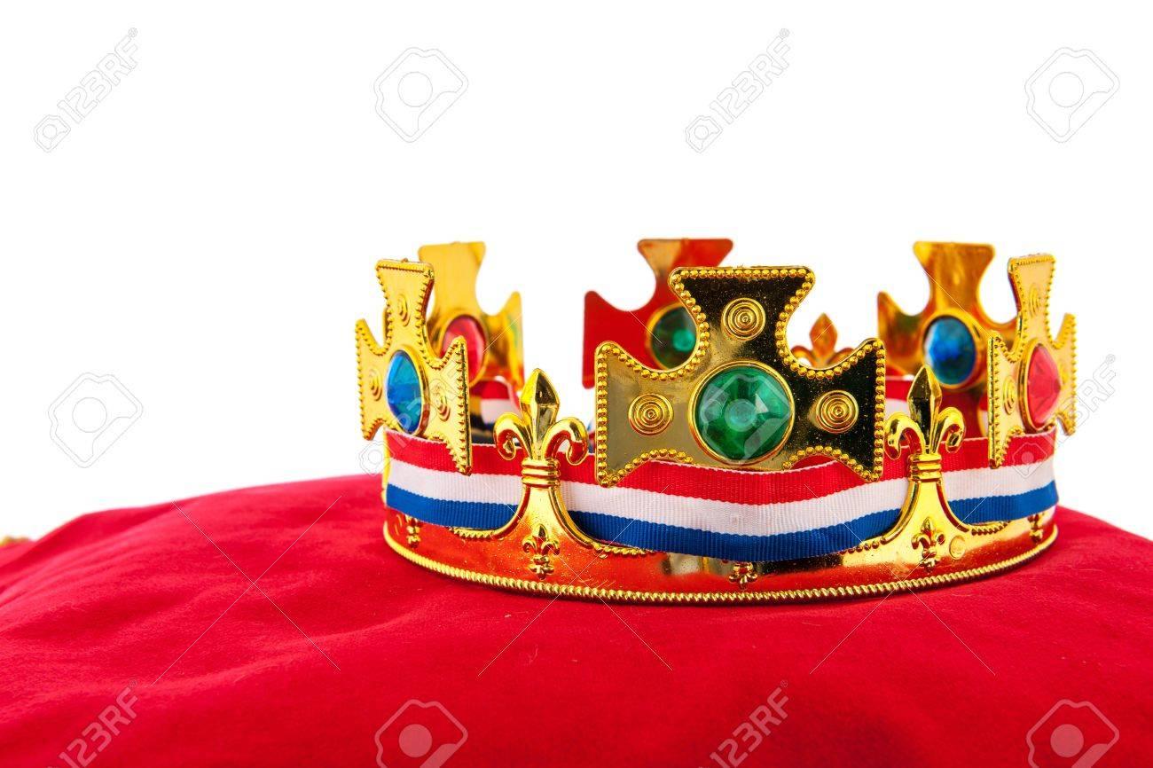 Golden crown on red velvet pillow for coronation in Holland Stock Photo - 19071188