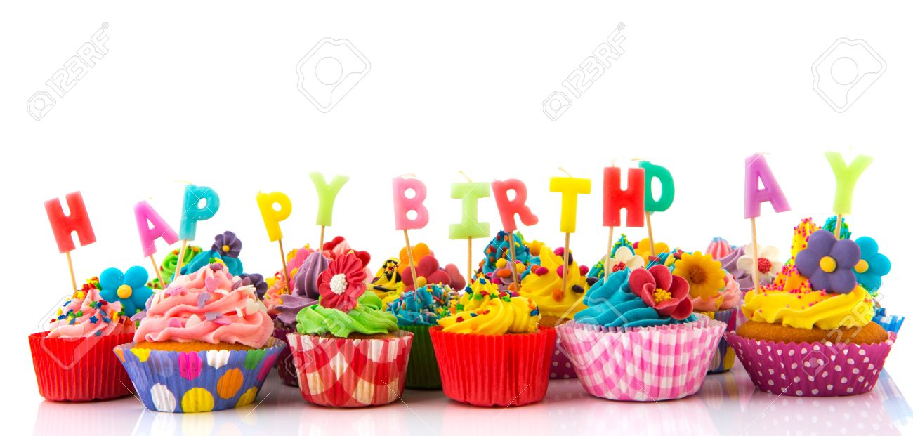 Colorful Happy Birthday Cupcakes With Candles Isolated Over White Background Stock Photo
