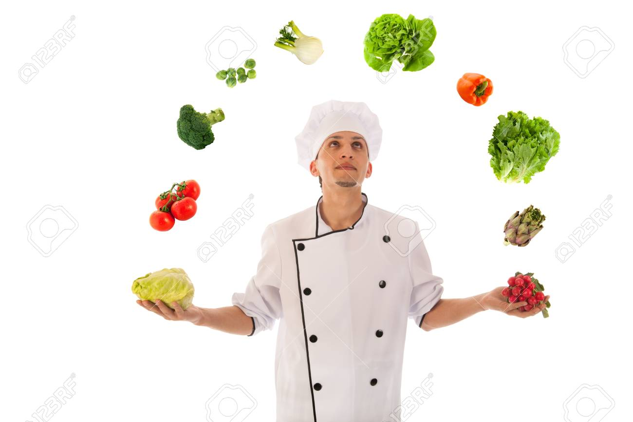 Cook juggling with assortment fresh vegetables isolated over white background Stock Photo - 19761185